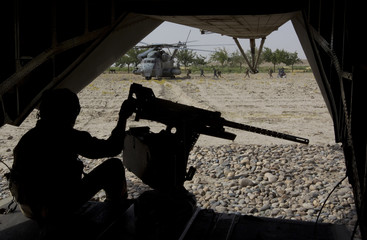 A gunner watches U.S. Marines and members of Afghan National Police board for Western Engagement operation at Camp Gorgak in Helmand province