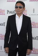 Taiwanese actor Doze Niu arrives at the 2013 Film Independent Spirit Awards in Santa Monica