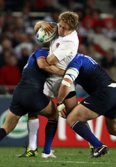 France's Morgan Parra and Fabien Barcella tackle England's Jonny Wilkinson during their Rugby World Cup quarter-final match at Eden Park in Auckland