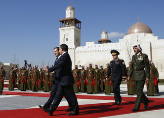 Jordan's King Abdullah welcomes Russia's President Medvedev at the Royal Palace in Amman