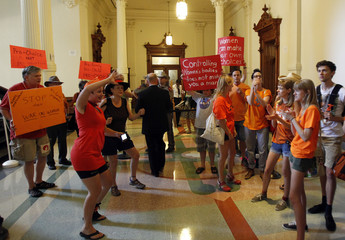 Abortion rights protesters rally outside the floor of the state Senate where they will meet to consider legislation restricting abortion rights in Austin, Texas