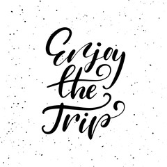 Enjoy the trip. Ink brush pen hand drawn phrase lettering design.