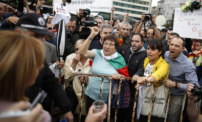 Protesters shout anti-government slogans in front of Bulgarian Socialist Party deputy Manolova during demonstration outside the parliament in Sofia