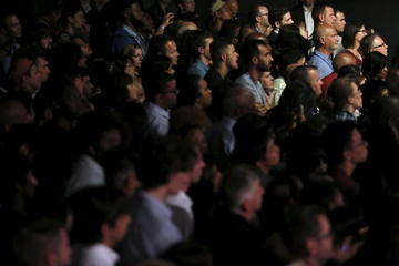 Supporters listen as U.S. President Barack Obama delivers remarks at a Democratic National Committee event in Austin, Texas