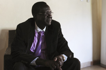 South Sudan's outgoing SPLA (Sudan People's Liberation Army) chief General James Hoth Mai sits in an armchair at his house in Juba