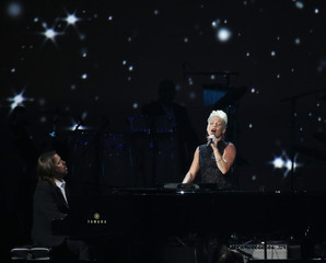 "Singer Pink and pianist Paul Mirkovich perform ""So Far Away"" during the 2014 MusiCares Person of the Year tribute honoring Carole King in Los Angeles"