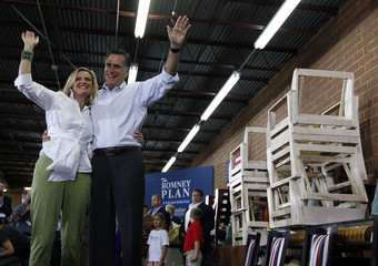 Republican U.S. presidential candidate Romney waves with his wife Ann during campaign stop at Absolute Style furniture store in High Point