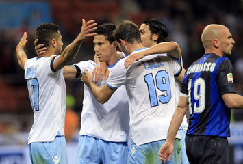 Lazio's Hernanes celebrates with team mates after scoring a goal against Inter Milan during their Italian Serie A soccer match at the San Siro stadium in Milan