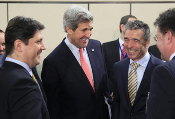 U.S. Secretary of State Kerry talks with Romania's Foreign Minister Corlatean and NATO Secretary General Rasmussen at Alliance's headquarters in Brussels