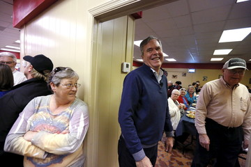 U.S. Republican presidential candidate Bush greets voters after speaking at Shealy's Bar-B-Que in Leesville