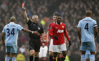Manchester City's Kompany is shown a red card by referee Foy during their FA Cup soccer match against Manchester United at the Etihad Stadium in Manchester