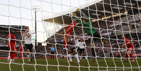 England's Upson heads to score against Germany during a 2010 World Cup second round soccer match at Free State stadium in Bloemfontein