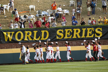 Tokyo, Japan players salute to spectators as they celebrate after winning the championship against Chula Vista, California during their Little League World Series championship baseball game in Williamsport