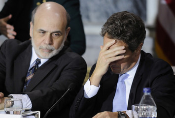 Geithner rubs his brow as he talks with Bernanke after a meeting of the Financial Stability Oversight Council in Washington