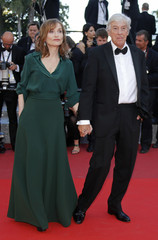 """Director Paul Verhoeven and cast member Isabelle Huppert pose on the red carpet as they arrivefor the screening of the film """"Elle"""" in competition at the 69th Cannes Film Festival in Cannes"""