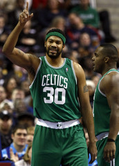 Boston Celtics forward Rasheed Wallace reacts after scoring against the Detroit Pistons during the second half of their NBA basketball game in Auburn Hills,