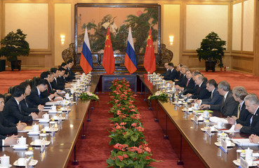 Russian President Putin and his delegation meet with Chinese President Hu after a welcoming ceremony for the Shanghai Cooperation Organization in Beijing