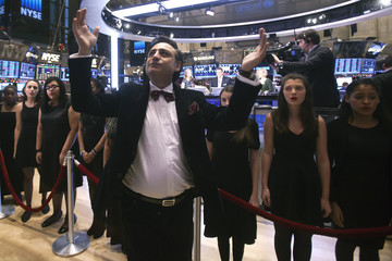Choir Director Ohanyan conducts the Professional Performing Arts School Choir as they sing Imagine on the floor of the New York Stock Exchange on New Year's Eve, the last trading day of the year, in New York