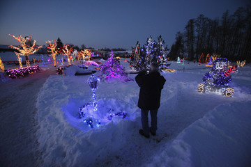 A visitor takes pictures of the scenery at a country house estate in the village of Grabovnica
