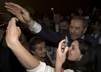 Canada's New Democratic Party (NDP) leader Tom Mulcair and his wife Catherine greet supporters at a campaign event in Vancouver