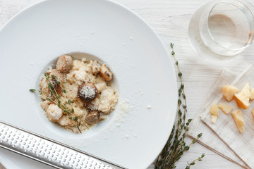 Wild mushrooms risotto with rosemary and parmesan, italian cuisine closeup