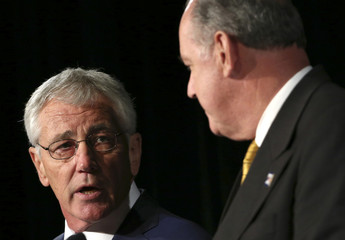 U.S. Defence Secretary Hagel looks towards Australia's Defence Minister Johnston as he speaks during a news conference in Sydney