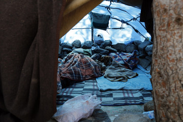 An African migrant sleeps at the hiding place in the Moroccan mountains near the North African enclave of Melilla