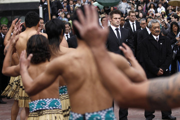New Zealand All Blacks captain McCaw stands next to Maori warriors during an official welcome ceremony for the Rugby World Cup in Auckland