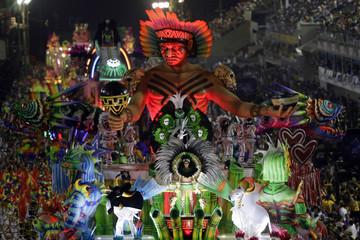 Revellers of the Mangueira samba school participate in the annual Carnival parade in Rio de Janeiro's Sambadrome