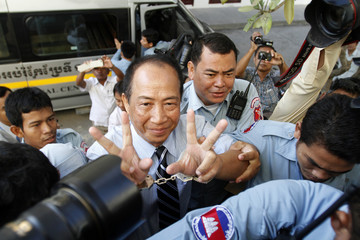 Mam Sonando, the owner of a local independent radio station, gestures during his arrival at the Appeal Court in Phnom Penh