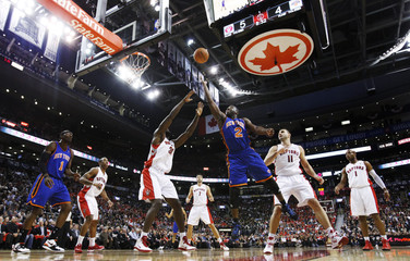 New York Knicks' Felton leaps for the basket against the Toronto Raptors during the first half of their NBA basketball game in Toronto