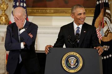 Vice President Joe Biden (L) reacts as President Barack Obama delivers remarks