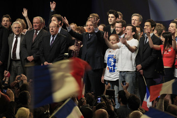 Francois Bayrou, France's centrist MoDem party leader and candidate for the 2012 French presidential election, reacts on stage at the end of a political rally in Lille