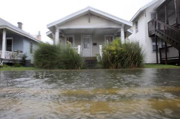 Intense rain from Hurricane Irene floods a residential street in Ocean City, Maryland