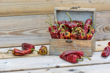 Healthy eating. Red dried peppers in a box.