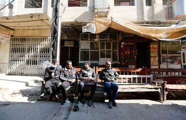 Iraqi men drank waterpipe at a coffee shop in the street of Mosul
