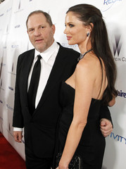 Producer Weinstein and his wife Chapman pose at The Weinstein Company and Relativity Media's after-party for 68th annual Golden Globe Awards in Beverly Hills
