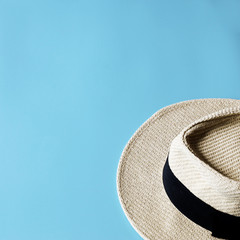 Panama hats on blue background ,copy space,minimal style