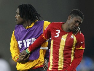 Ghana's Asamoah Gyan is consoled after the 2010 World Cup quarter-final soccer match between Uruguay and Ghana at Soccer City stadium in Johannesburg