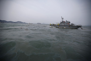 Leaked oil is seen on the surface of the sea near the site where the capsized passenger ship Sewol sank, in the sea off Jindo