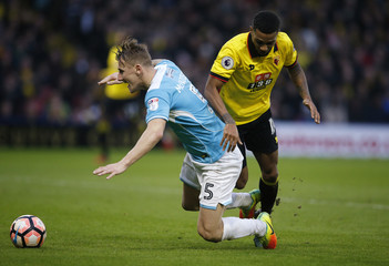 Burton Albion's Kyle McFadzean in action with Watford's Jerome Sinclair