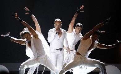 """Giorgos Alkaios and Friends from Greece perform their song """"OPA"""" during a dress rehearsal for semi-final one of the Eurovision Song Contest in Oslo"""