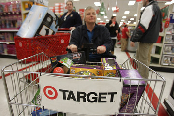 """A woman rides a motorized shopping cart through a Target store on the shopping day dubbed """"Black Friday"""" in Torrington"""