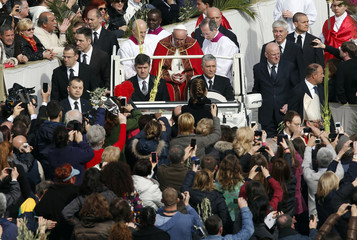 Pope Francis arrives to lead the Palm Sunday mass on the Popemobile at Saint Peter's Square at the Vatican