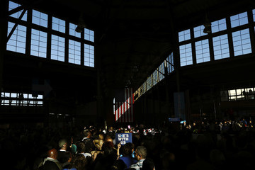Supporters wait for U.S. Democratic presidential nominee Hillary Clinton to arrive at a campaign rally in Detroit, Michigan