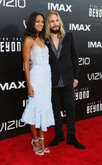 "Zoe Saldana and Marco Perego arrive for the world premiere of ""Star Trek Beyond"" in San Diego"