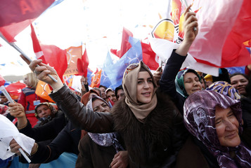 Supporters of ruling AK Party (AKP) wave party flags during an election rally in Kirikkale