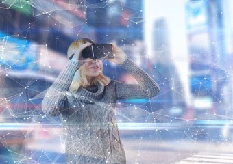 Woman using 3D glasses to see an interface in a futuristic room