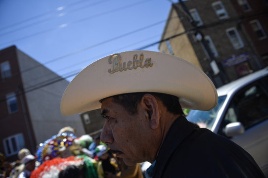 Puebla is emblazoned on a man's cowboy hat during the Carnaval de Puebla in Philadelphia