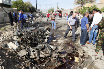 Iraqi security personnel are seen at the site of a bomb attack in Kirkuk